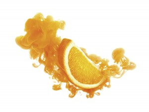 Orange fruit on ink isolated over white background